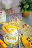 Greek yogurt with granola and peach Royalty Free Stock Image