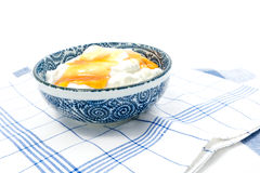 Greek yogurt with honey in a pot Stock Photography