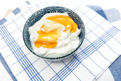 Greek yogurt with honey in a pot Stock Images