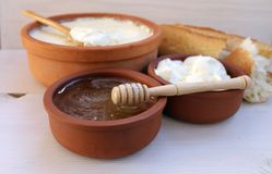 Greek yogurt natural dairy products in ceramic cup, honey, bread Royalty Free Stock Photography
