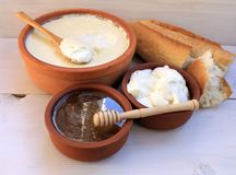 Greek yogurt natural dairy products in ceramic cup, honey, bread Royalty Free Stock Image