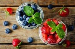 Greek yogurt strawberry and blueberry parfaits with fresh berries stock image