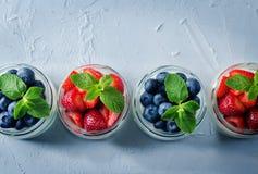 Greek yogurt strawberry and blueberry parfaits with fresh berries stock photo