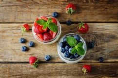 Greek yogurt strawberry and blueberry parfaits with fresh berries stock images