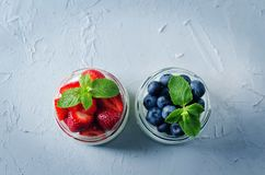 Greek yogurt strawberry and blueberry parfaits with fresh berries royalty free stock photos
