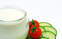 Greek yogurt. With tomatoes and gherkin royalty free stock photos