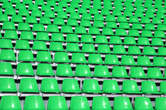 Greem seats in a Sports Venue without people Stock Photos