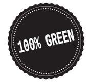 100%-GREEN文本,在黑贴纸邮票 库存照片