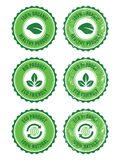 Green 100% organic natural eco retro labels. Green vintage badges - grunge style. Ecology, bio, recycling, healthy food concept Royalty Free Stock Photo