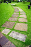 Green. Stone walkway in the park with green grass Royalty Free Stock Images
