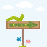 Green. Caterpillar sits on the sign go Stock Images