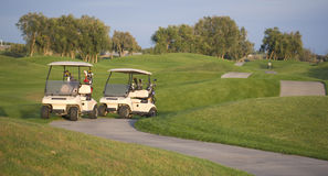 Town Golf Course Carts on Path Evening Sunset Royalty Free Stock Image