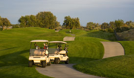 Two Carts Parked on Pathway Manicured Golf Course Stock Image
