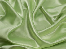 Green ablaze  satin background Stock Image