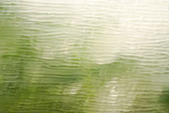 Green Abstract Background. A green wavy abstract background with highlights Stock Photo