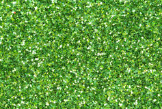 Green abstract background. Christmas glitter closeup photo. Green abstract background. Green glitter closeup photo. Green shimmer wrapping paper. Sparkling Royalty Free Stock Photography