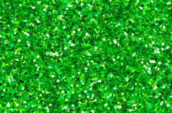 Green abstract background. Green glitter closeup photo. Green shimmer wrapping paper. Sparkling glitter festive backgrop. Christmas or New Year template Royalty Free Stock Photography