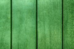 Green Abstract Background texture of wooden decking with parallel planks with gaps.  royalty free stock image