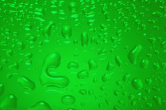 Green abstract background with water drops Royalty Free Stock Images