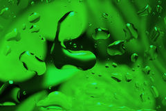 Green abstract background with water drops Royalty Free Stock Photos
