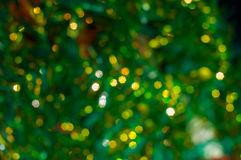Green abstract background with yellow bokeh Stock Photo