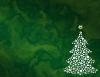 Green abstract Christmas background. Green background with white snowflake Christmas tree Royalty Free Stock Photo