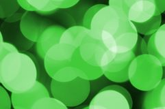 Green abstract Christmas blurred luminous background. Defocused artistic bokeh lights image stock photos