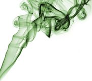Green abstract smoke from the aromatic sticks on a white background. Stock Photography