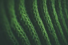 Green abstract texture and background. Green knitted texture and background for designers. Macro view of knitted fibers. Stock Photo