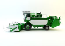 Green agricultural combine-harvester Royalty Free Stock Photos