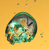 Green air bubble in water Royalty Free Stock Photo