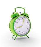 Green alarm clock. With  hands made out of grass strands Stock Images