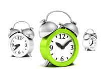Green alarm clock different out from whites Stock Photos