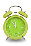 Green alarm clock with hands at 5 minutes till 12 isolated on white background Stock Images