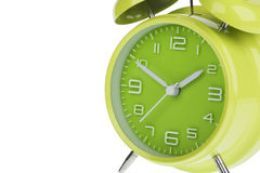 Green alarm clock with the hands at 10 and 2 isolated on a white background Stock Photo