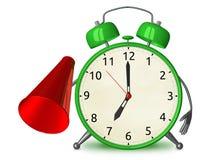 Green alarm clock with megaphone Royalty Free Stock Photo