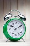 Green alarm clock morning wake-up time Royalty Free Stock Photo