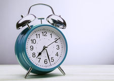 Green alarm clock morning wake-up time Royalty Free Stock Photos