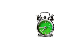 Green alarm clock over white royalty free stock images