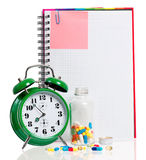 Green alarm clock with pills Royalty Free Stock Images