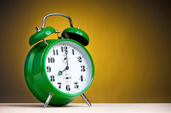 Green alarm clock Stock Photo