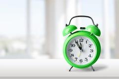 Green alarm clock. Second reminder pastel old bell awake Stock Photos