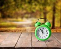Green alarm clock. Second reminder pastel old bell awake Stock Images