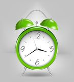 Green alarm clock. Vector Stock Photography
