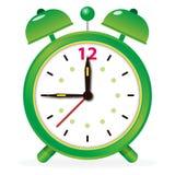 Green alarm clock on white Royalty Free Stock Photos