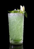 Green alcohol cocktail. On a black background Stock Photo