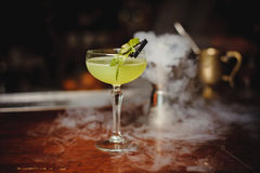 Green alcohol cocktail with lime Royalty Free Stock Photos