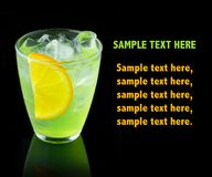 Free Green Alcohol Cocktail With Lemon Slice Isolated On Black Stock Photography - 110560902