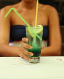 Green alcoholic cocktail in a tall glass Stock Photography
