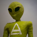 The green Alien and his sign Stock Photos